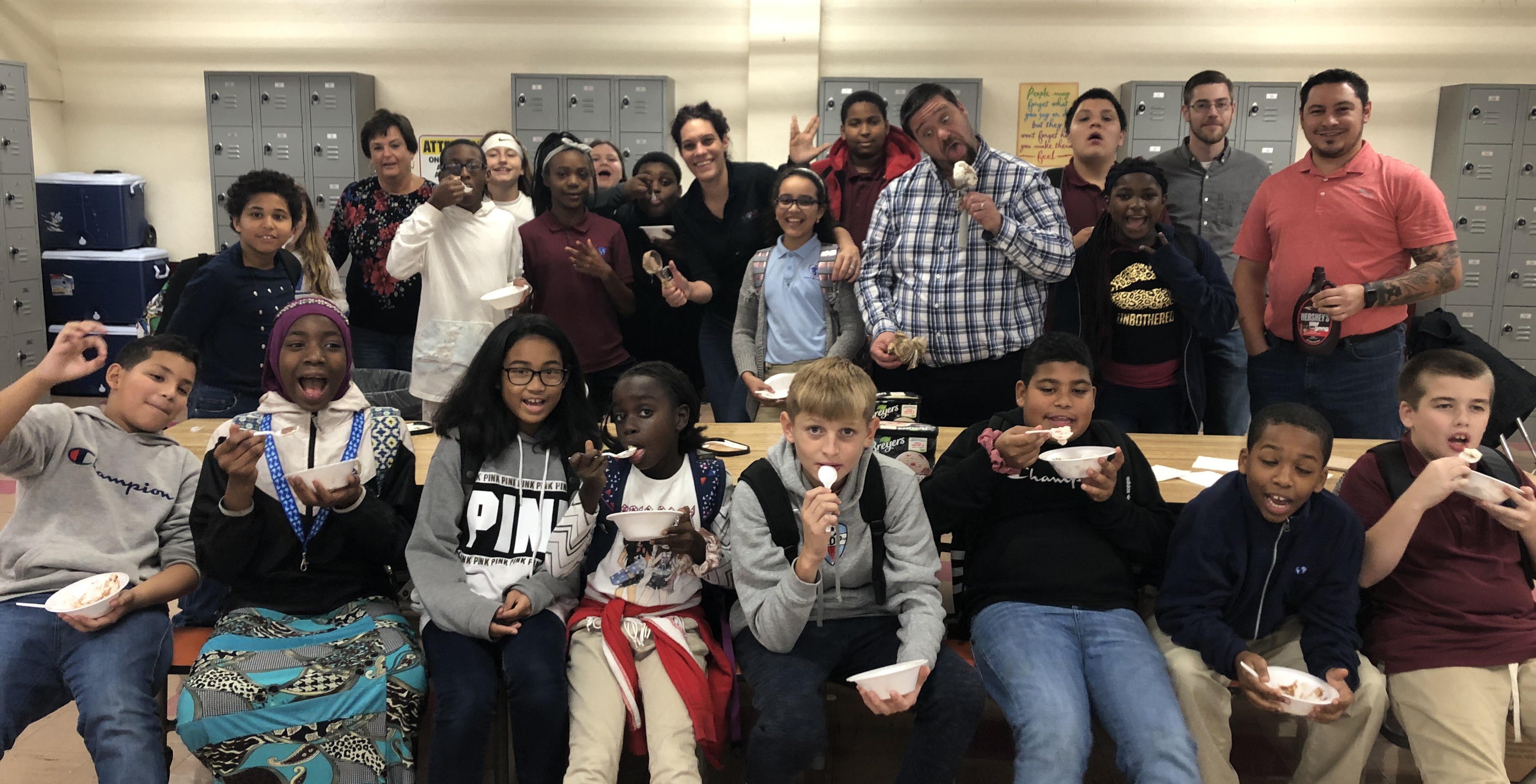 Middle school Atoms enjoy an ice cream social for receiving 25 merits