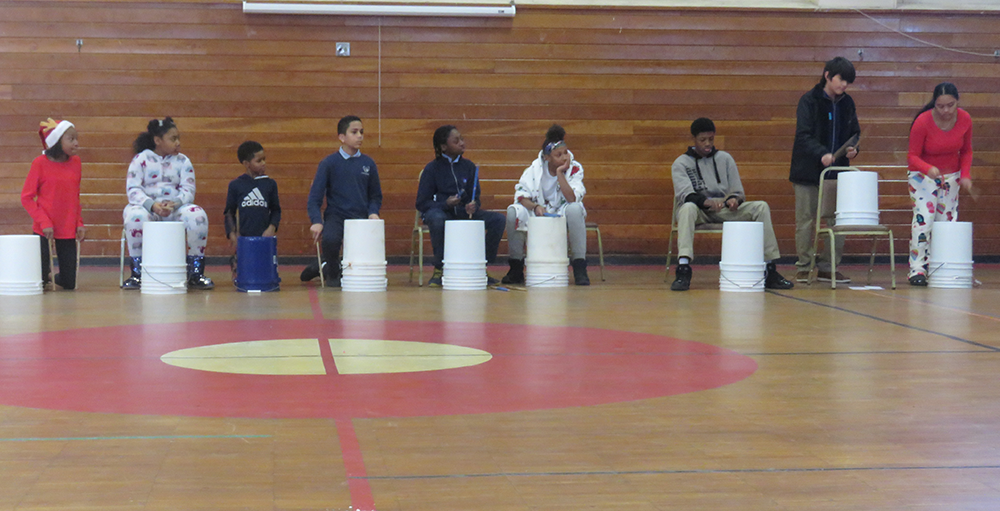Middle school Atoms enjoyed jamming in a 'drumline' on buckets during their festivities leading up to winter recess