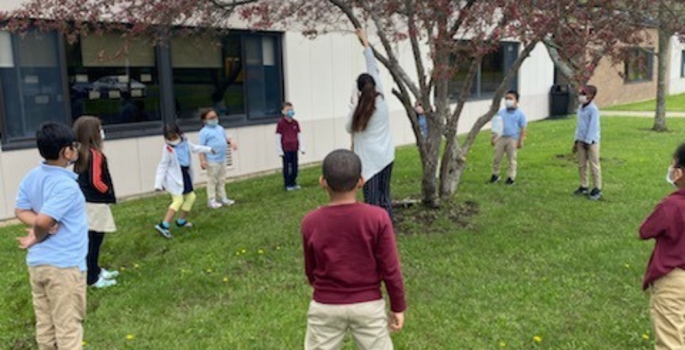 First grade students celebrated Earth Day by creating a bird feeder out of upcycled material.
