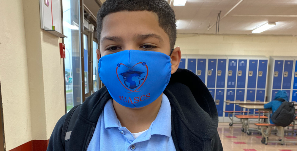 A custom face mask with the school logo for the 2020 - 2021 school year